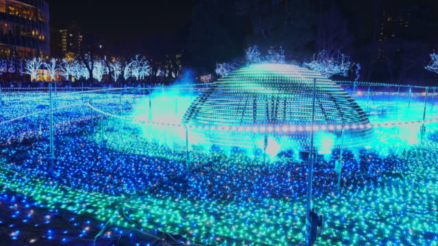 over 500,000 led lights are displayed in the starlight garden (grass square) and glow in the night in roppongi tokyo on december 21 2017. people are watching and photographing illumination. - roppongi stock videos and b-roll footage