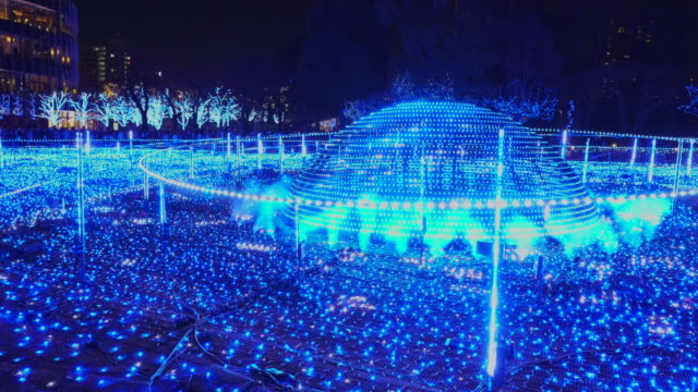 over 500,000 led lights are displayed in the starlight garden (grass square) and glow in the night in roppongi tokyo on december 21 2017. people are watching and photographing illumination. - tokyo midtown stock videos & royalty-free footage