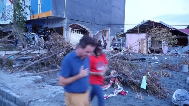 Over 840 confirmed dead in aftermath of tsunami Palu Saulwesi Indonesia various of tsunami and earthquake aftermath interview with survivors Sulawesi...