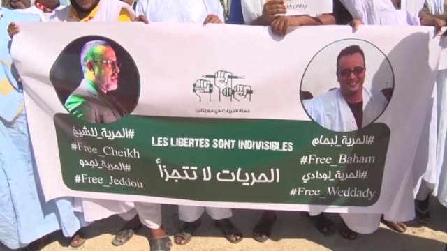 over a hundred people demonstrate outside nouakchott's central prison to demand the release of two mauritanian bloggers abderrahmane ould wedadi and... - blogging stock videos & royalty-free footage