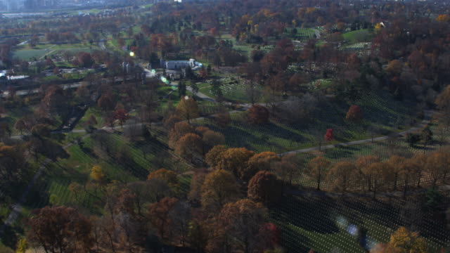 over arlington national cemetery, looking toward women in military service to america memorial. shot in 2011. - arlington virginia video stock e b–roll