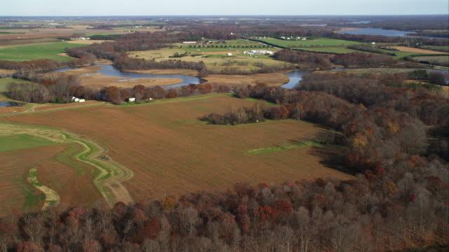 over autumn farmland east of chesapeake bay, maryland. shot in november 2011. - artbeats video stock e b–roll