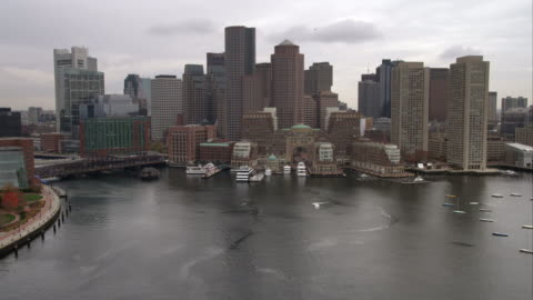 over boston harbor, passing downtown. shot in november 2011. - harbour stock videos & royalty-free footage