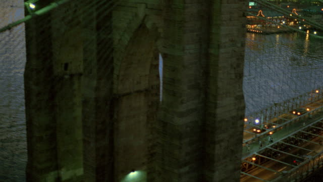 vidéos et rushes de aerial over brooklyn bridge + east river towards manhattan at sunset / nyc - 1990 1999