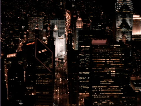 aerial over buildings in downtown chicago at night - トリビューンタワー点の映像素材/bロール