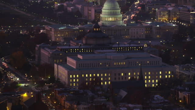 Over Capitol Hill, past Capitol, Library of Congress, and Office of Compliance; Pennsylvania Avenue at left as clip ends. Shot in 2011.