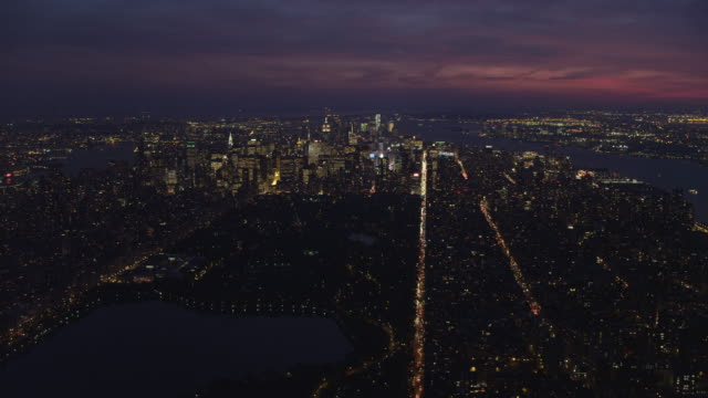 Over Central Park at dusk, looking toward Times Square and Lower Manhattan, Hudson River and East River in view at right and left respectively. Shot in November 2011.