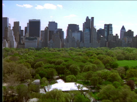 aerial over central park toward midtown nyc - cinematography stock videos & royalty-free footage