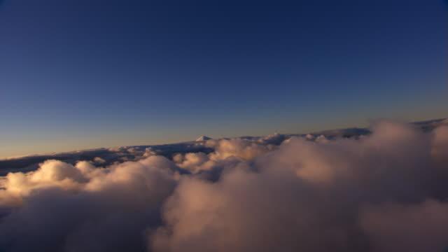 Over cloud bumps toward peak