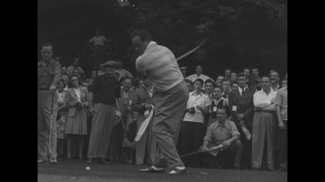pan over crowd of spectators on hills at royal york golf club / ms entertainer bob hope teeing off then admiring his shot / ms american golfer al... - golf links stock videos and b-roll footage