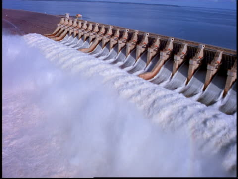 AERIAL over dam with flowing water