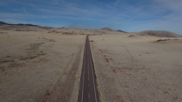 over desert road straight - drone aerial 4k arizona desert, open plain, trail, adventure, discovery landscape, reveal, beautiful, prairie 4k nature/wildlife/weather drone aerial view - empty road stock videos and b-roll footage