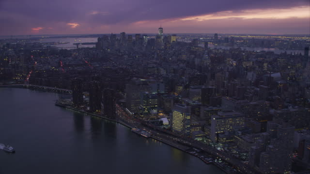 Over East River, looking toward Lower Manhattan and Financial District at dusk. Shot in November 2011.