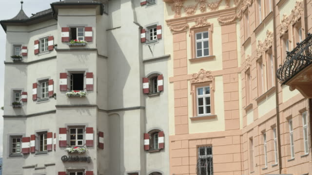 ls pan over facades to ottoburg, one of the most popular restaurants in town and a historical landmark. built as part of the innsbruck castle (11th /12th century) famous former residents include the two sons of emperor maximilian i, phillip of spain, etc. - innsbruck stock videos and b-roll footage
