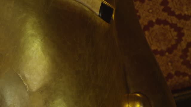 'LS CU TD over face of Reclining Buddha, from eyes to lips, RED R3D 4K'