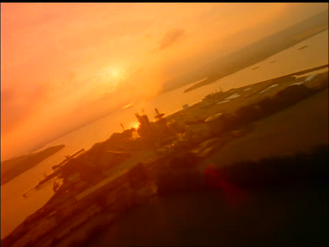 aerial over factory on coast at sunset / cork harbour, county cork, ireland - county cork stock videos & royalty-free footage