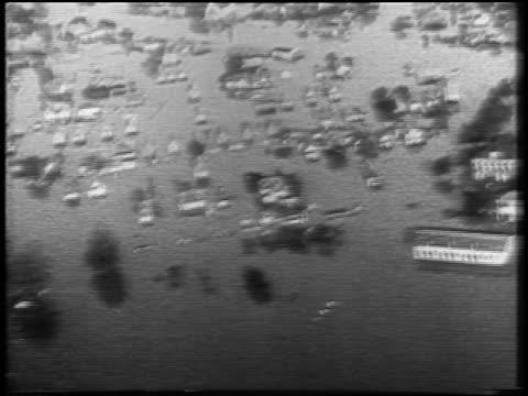 AERIAL over flooded town / newsreel