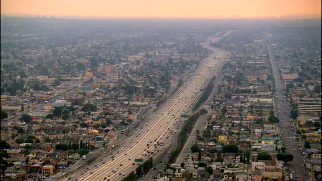 vídeos y material grabado en eventos de stock de aerial over freeway in south central los angeles heading towards long beach / los angeles, california - 2005