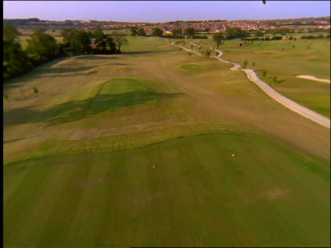 aerial over golf course / england - green di golf video stock e b–roll
