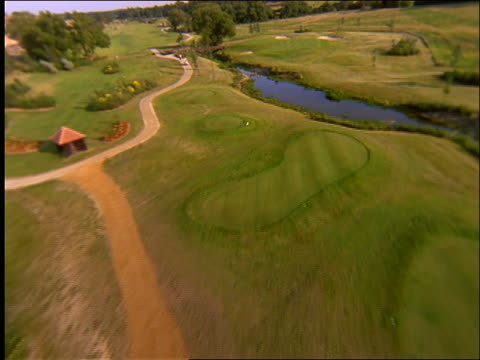 aerial over golf course / england - northampton stock-videos und b-roll-filmmaterial