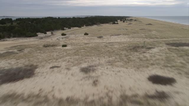 Over grassy dunes, approaching Cape Poge Bay, Massachusetts. Shot in November 2011.