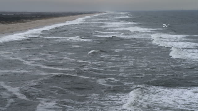over gray atlantic waves near jones beach on long island, new york. shot in november 2011. - artbeats stock videos & royalty-free footage