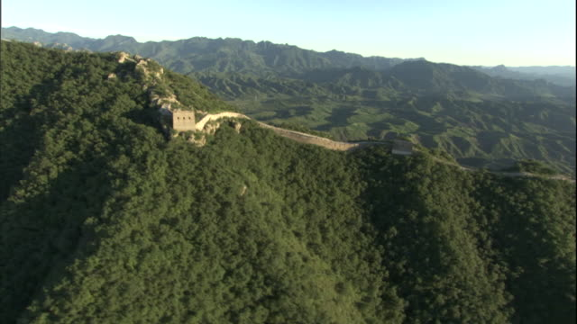 AERIAL over Great Wall with mountains in background/ China
