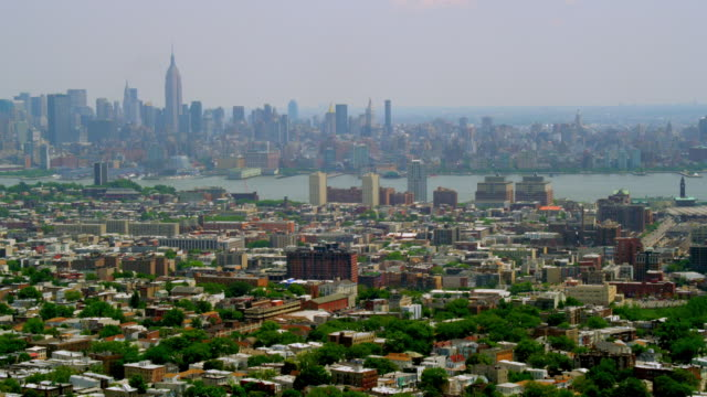 WIDE AERIAL over Hoboken with Hudson River and Midtown Manhattan skyline in background