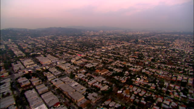 AERIAL Over Hollywood heading northeast towards Hollywood Hills / Los Angeles, California
