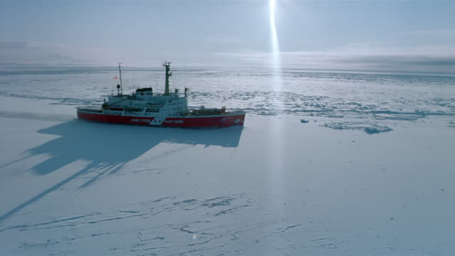 IAERIAL over ice breaker ship moving through frozen water / Canada