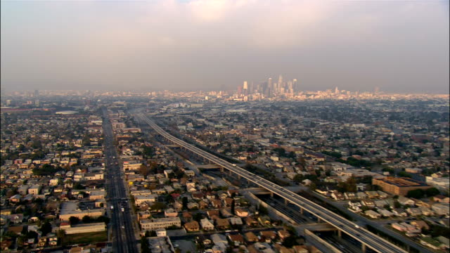 AERIAL Over Los Angeles with view of downtown skyline on smoggy day / California