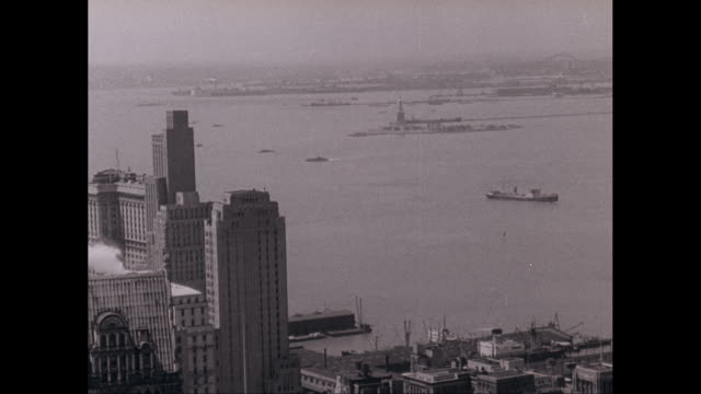 WS ZI over lower Manhattan to Statue of Liberty in New York Harbor /  New York City, New York, United States United States