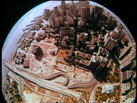 fisheye aerial over manhattan streets, rivers, + buildings / new york city - 2001 stock-videos und b-roll-filmmaterial