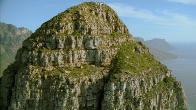aerial over mountain (lion's head?) towards cape town / south africa - lion's head mountain stock videos and b-roll footage