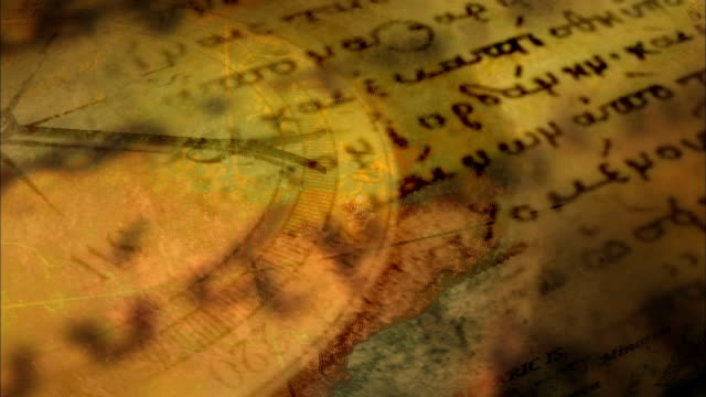 vidéos et rushes de cgi composite ms pan over old map with compass and ancient text overlaid  - antique