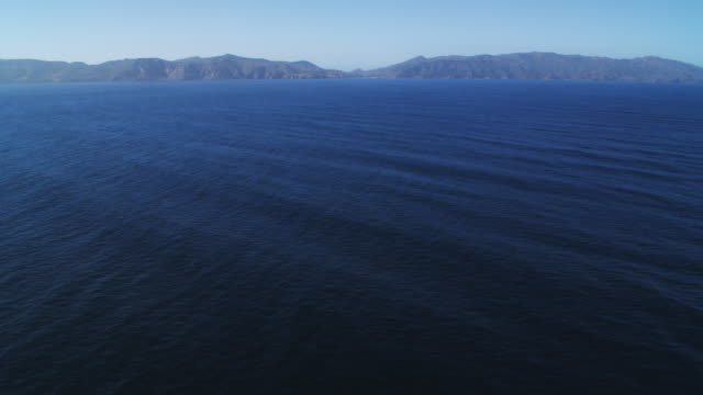 over open water toward isthmus cove on santa catalina island - artbeats stock videos & royalty-free footage