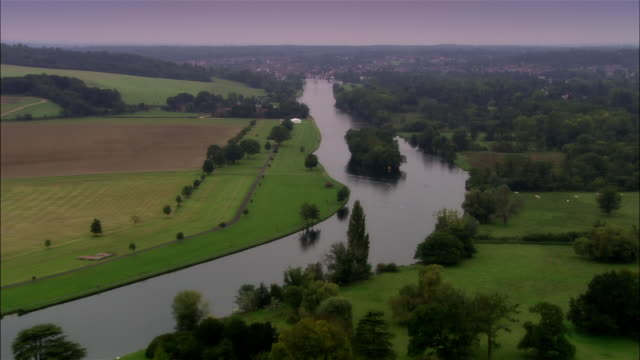 aerial, over river thames towards henley-on-thames, oxfordshire, england - oxfordshire stock videos & royalty-free footage