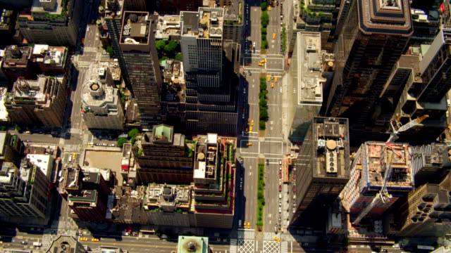 AERIAL OVERHEAD over rooftops of office buildings and light traffic on Park Avenue