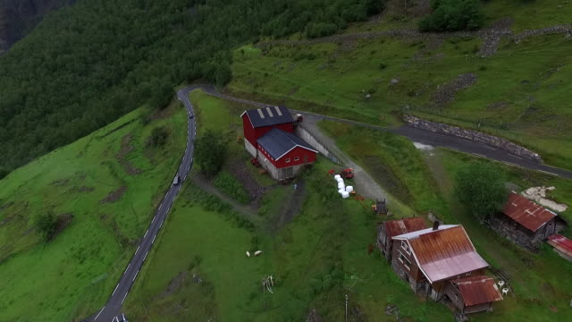 over rooftops on hillside with winding road - norway stock videos & royalty-free footage