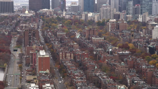 Over row houses in Boston's North End; capitol and Old North Church in front of skyscrapers in background. Shot in November 2011.