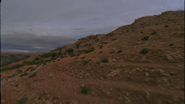 aerial over rugged landscape/ morocco - okänt kön bildbanksvideor och videomaterial från bakom kulisserna
