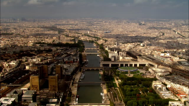 aerial over seine with bridges, palais omnisports de paris-bercy, and the national library/ paris, france - river seine stock videos & royalty-free footage