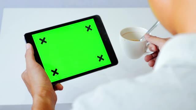 over shoulder shot of using digital tablet,green screen - over shoulder stock videos & royalty-free footage