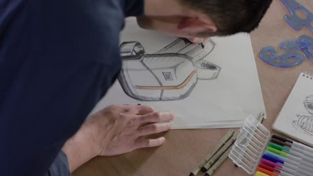 over shoulder view of a man sketching - illustrator stock videos and b-roll footage
