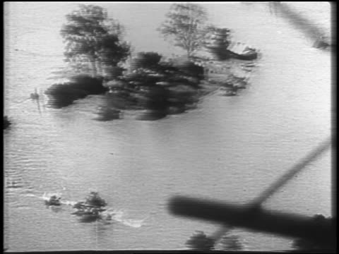 AERIAL over small island in flood waters of Mississippi River / newsreel