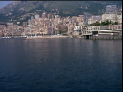 AERIAL over speedboat on ocean to Monaco + harbor / Provence, France (Riviera)