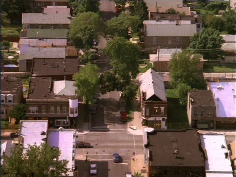 aerial over suburban buildings, houses + streets / chicago - residential district stock videos & royalty-free footage