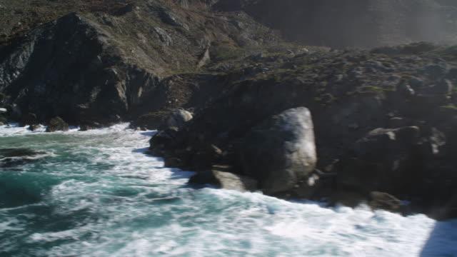 over surf along the coastline of santa catalina - artbeats stock videos & royalty-free footage