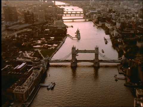 aerial over thames and tower bridge at sunset / london - tower bridge stock videos & royalty-free footage