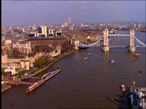 aerial over thames river and tower bridge / london - river thames stock videos & royalty-free footage